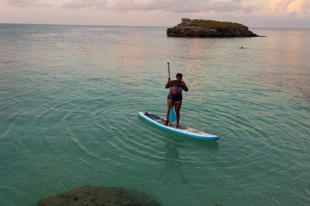 Black woman paddle boarding
